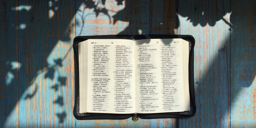 bible open on blue table