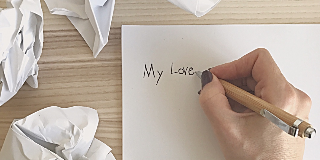 writing on paper with pencil with crumpled paper
