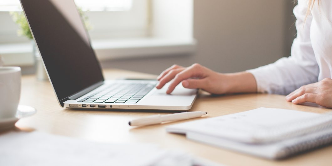 This is a picture of a woman at a desk with a laptop. This is a post about Affiliate Marketing For Bloggers