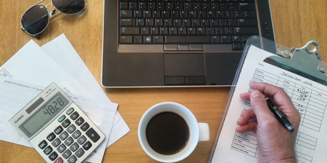 This is a desk with coffee and a calculator on it. This is a post about Affiliate Marketing Tips