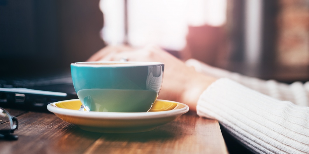 this is a picture of a blue coffee cup and someone typing on a laptop. This is a blog post about email marketing benefits